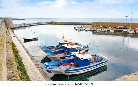 Fishing boats in a protected basin at the harbour in ITaly