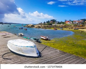 Fishing boats and seafront on Carbonera beach in Arousa Island, Galicia, Spain