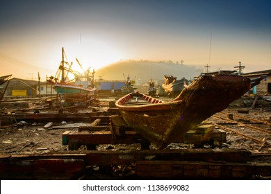 Fishing boats in a shipyard for maintenance.