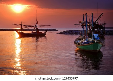 Fishing boats and sun rise in Thailand