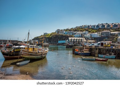 Fishing boats in the sunny harbor of Mevagissey