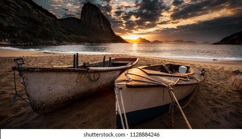 Fishing boats at sunrise in the beach of Rio de Janeiro
