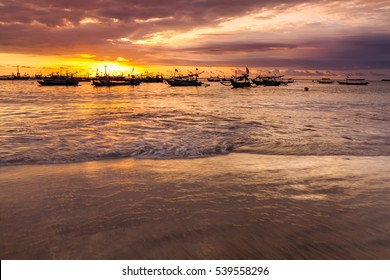 Fishing boats at sunset on the beach. Bali