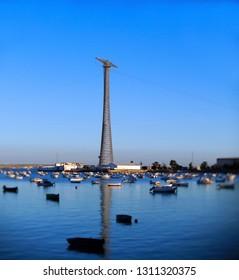 Fishing boats in sunset at the Puente de la Constitución, called La Pepa, in the bay of Cádiz, Andalusia. Spain. Europe