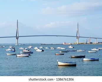 Fishing boats in sunset at the Puente de la Constitucion, called La Pepa, in the bay of Cadiz, Andalusia. Spain. Europe