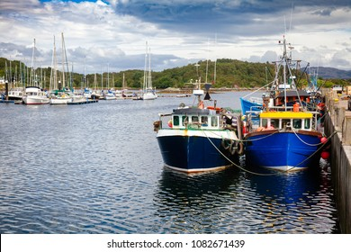 Fishing boats tied up at Tarbert, a small fishing town and ferry terminal in Argyll and Bute, Scotland, UK
