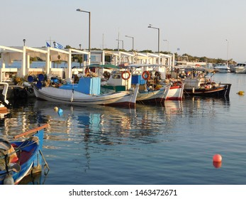 Fishing boats in the town harbor, in Glyfada, Attica, Greece