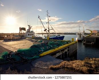 Fishing boats at waterfront harbor of Hvammstangi, Iceland