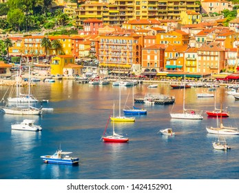 Fishing boats and yachts in the Villefranche-sur-Mer bay. Landscape of the Cote d'Azur, Villefranche-sur-Mer, France