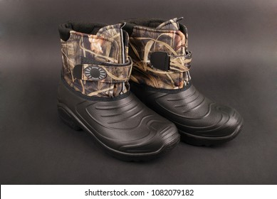 Fishing boots for hiking, fishing, traveling. isolated on black