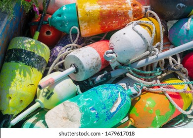 Fishing Buoys are brightly colored in a pile