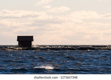 Fishing cabin by seaside in a stormy water