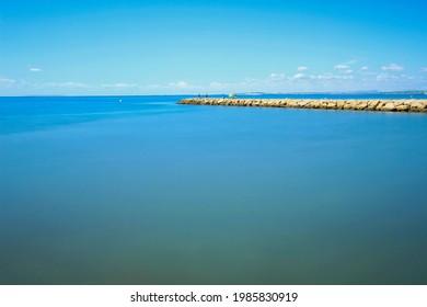 Fishing day on a breakwater under the sun in Santa Pola, Spain - Shutterstock ID 1985830919