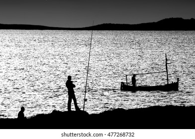 fishing, the decisive moment, tribute to Cartier Bresson, allegory of visual balance,visual allegories, visual metaphors, photographic allegories, photographic metaphors, black and white photo,ibiza,