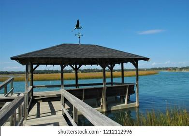 A fishing dock along a marsh.