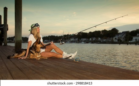 Fishing of the dock with a German Shepard