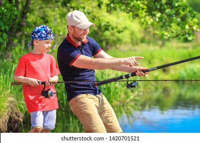 Fishing. Fishermen on lakeside. Family fishing. Father and son on summer lake catch fish. Man with child with spinnings