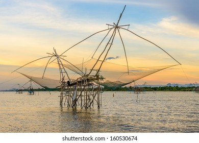 Fishing gear. Bamboo and netting. Of fishermen in Phatthalung Thailand On a beautiful evening light.
