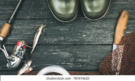 Fishing gear - fishing, fishing, hooks and baits, on a wooden background. Toned image