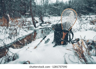 Fishing gear on the bank of a winter river.