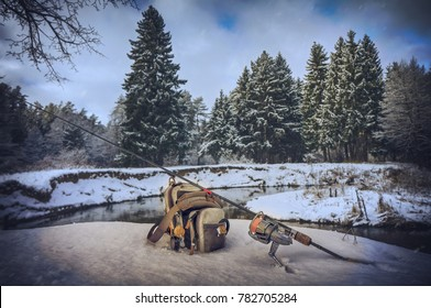 Fishing gear on a winter, snow-covered river.