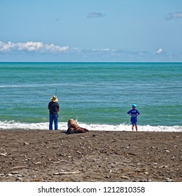 Fishing with grandad on a sunny day on the west coast, New Zealand