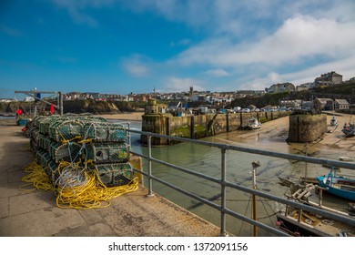 Fishing harbor with lobster baskets in Cornwall