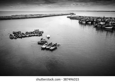 Fishing harbor with several fishing boats in El Jadida (Morocco).