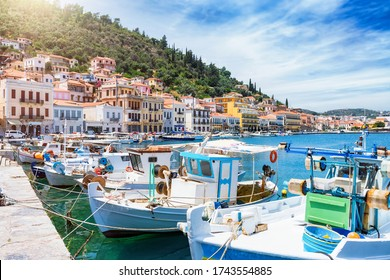 The fishing harbour of the coastal town Gytheio, south Peloponnese, Greece, with traditional Greek fishing boats lined up the pier