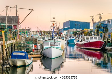Fishing Harbour with Colourful Boats at Sunset