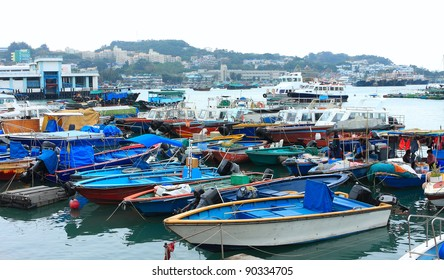 Fishing and house boats anchored in Cheung Chau harbour. Hong Kong.