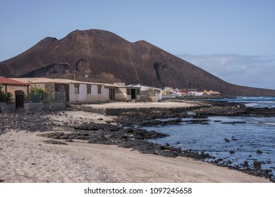 Fishing houses and volcano on the coast of Calhau, island of San Vicente, Cape Verde