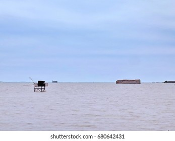 Fishing hut off Fouras, Fort Enet and Fort Boyard, France. Photo taken from the view point of Pointe de la Fumée.