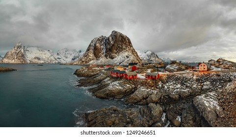 Fishing hut (rorbu) in the Hamnoy and Lilandstinden mountain peak at sunset - Reine, Lofoten islands, Norway