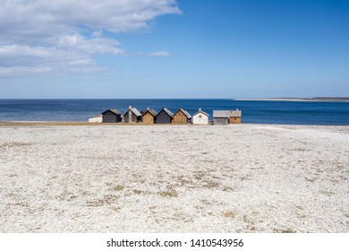 fishing huts in Fårö Gotland Helgumannens fiskeläge with sea horizon in the background