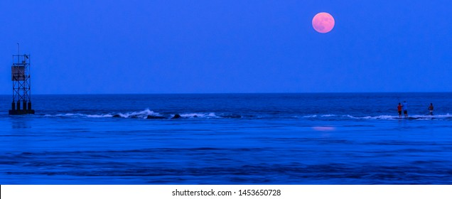 Fishing the Indian River Inlet during a full moon and high tide.