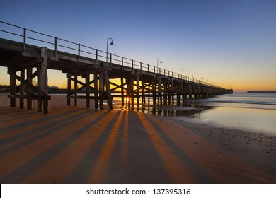 Fishing jetty at first light against morning sky