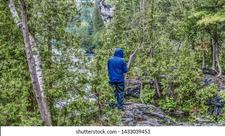 Fishing at a lake in the rain