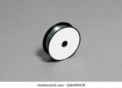 Fishing Line Mock-up with blank label on gray background.High resolution photo.Top view.