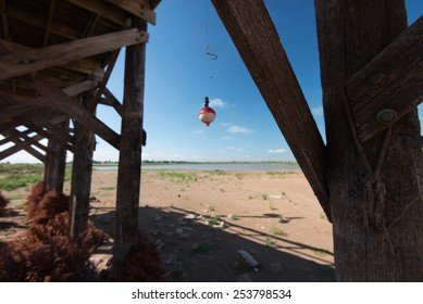 A fishing lure dangles below a dock exposed by low levels in Lake Arrowhead, Wichita Falls, Texas' drinking water supply