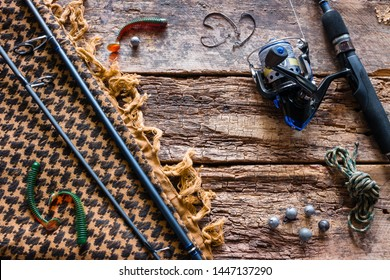 fishing lures and tackle on a wooden background with place for text. baits, hooks, fishing tackle