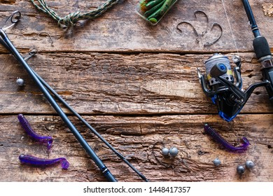 fishing lures and tackle on a wooden background with space for text