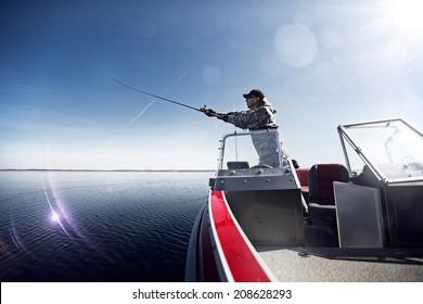 Fishing man in boat