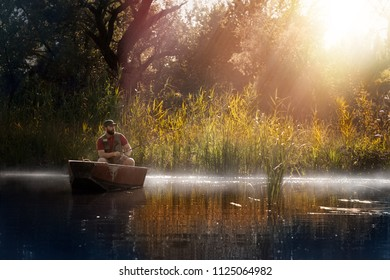 Fishing. Man fishing on a lake from boat in incredible nature