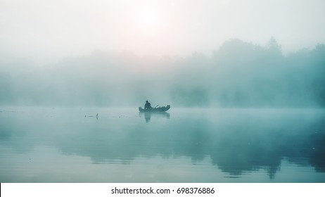 Fishing. A misty morning in a boat.