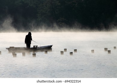 fishing in the morning fog on a lake