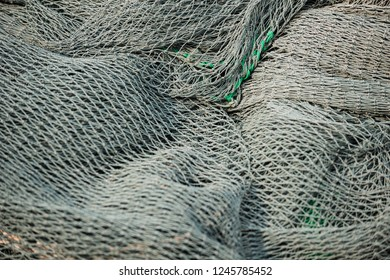 Fishing net close-up texture background grey and green pattern