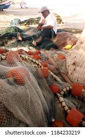 fishing net at the Coast at the beach in the town of Manzanillo on the Isla Margarita in the caribbean sea of Venezuela.  Venezuela, Isla Margarita, November, 2005