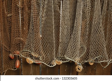 Fishing net is hanging on the wall