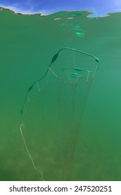 Fishing net with lifting bodys underwater in the freshwater lake near the surface